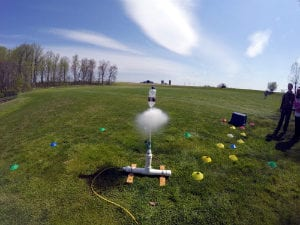 Shooting Off Water Rocket in Field